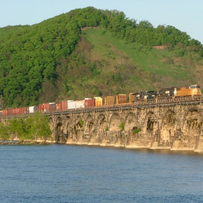 UP SD60M Leads A Manifest Across Rockville Bridge