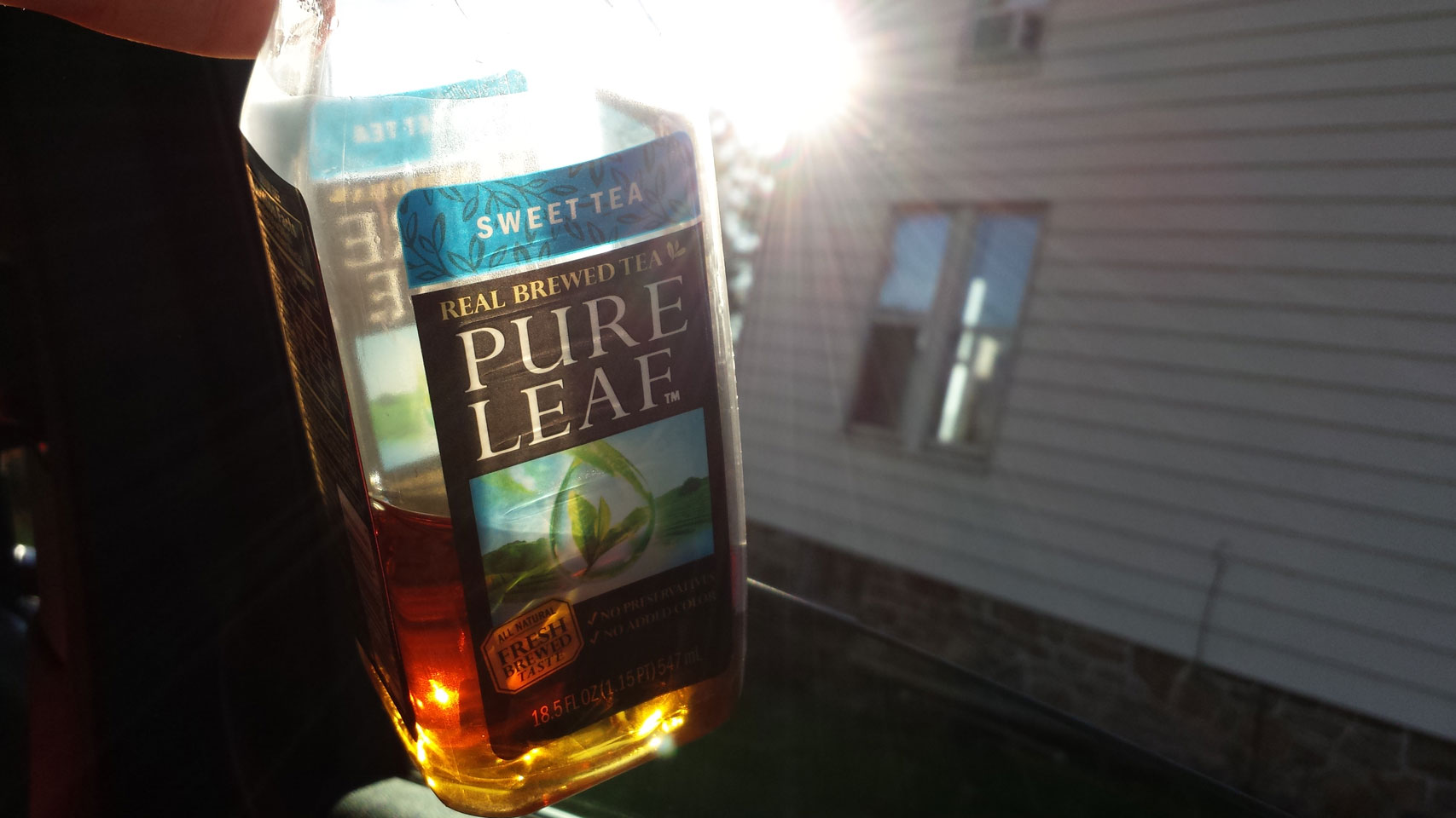 It's full of a brown liquid, is it iced tea? Is it some other product of the south? Hmm...