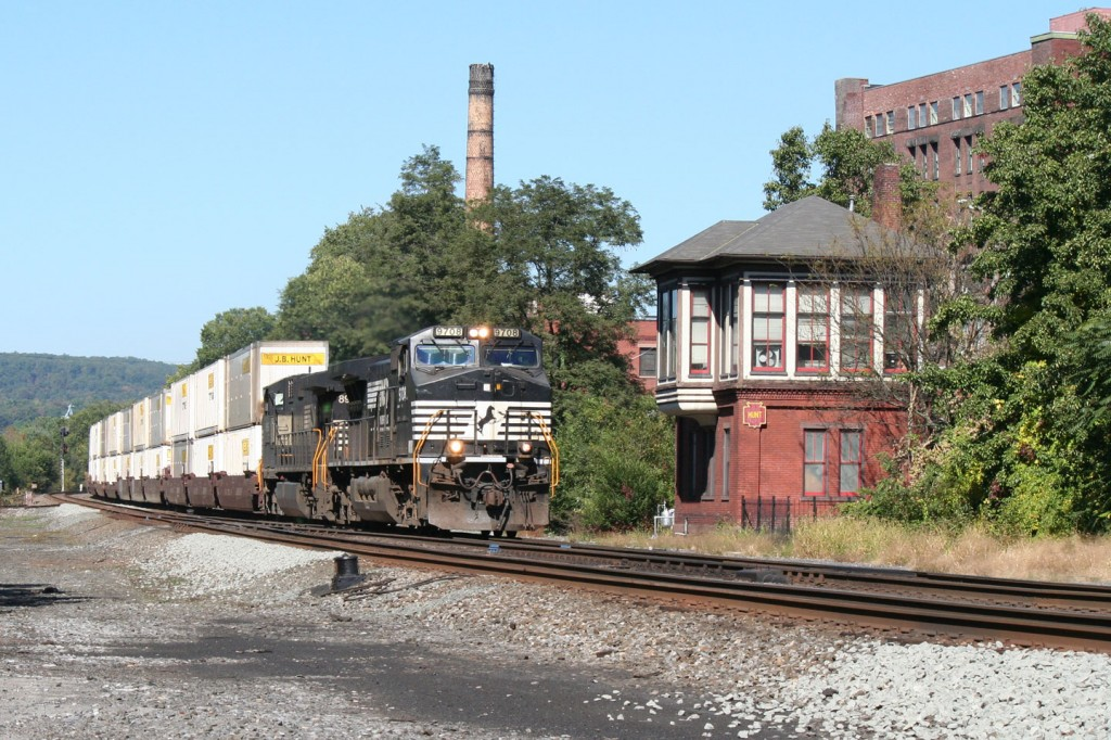 One of NS's fleet of stack trains roars past HUNT tower.