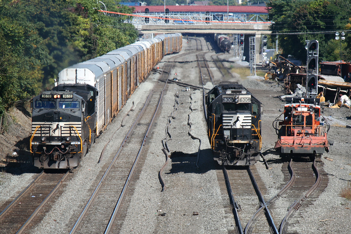 A westbound auto rack train rolls through CP Altoona where, just a week previously, a westbound version derailed causing the mess you see in the photo.