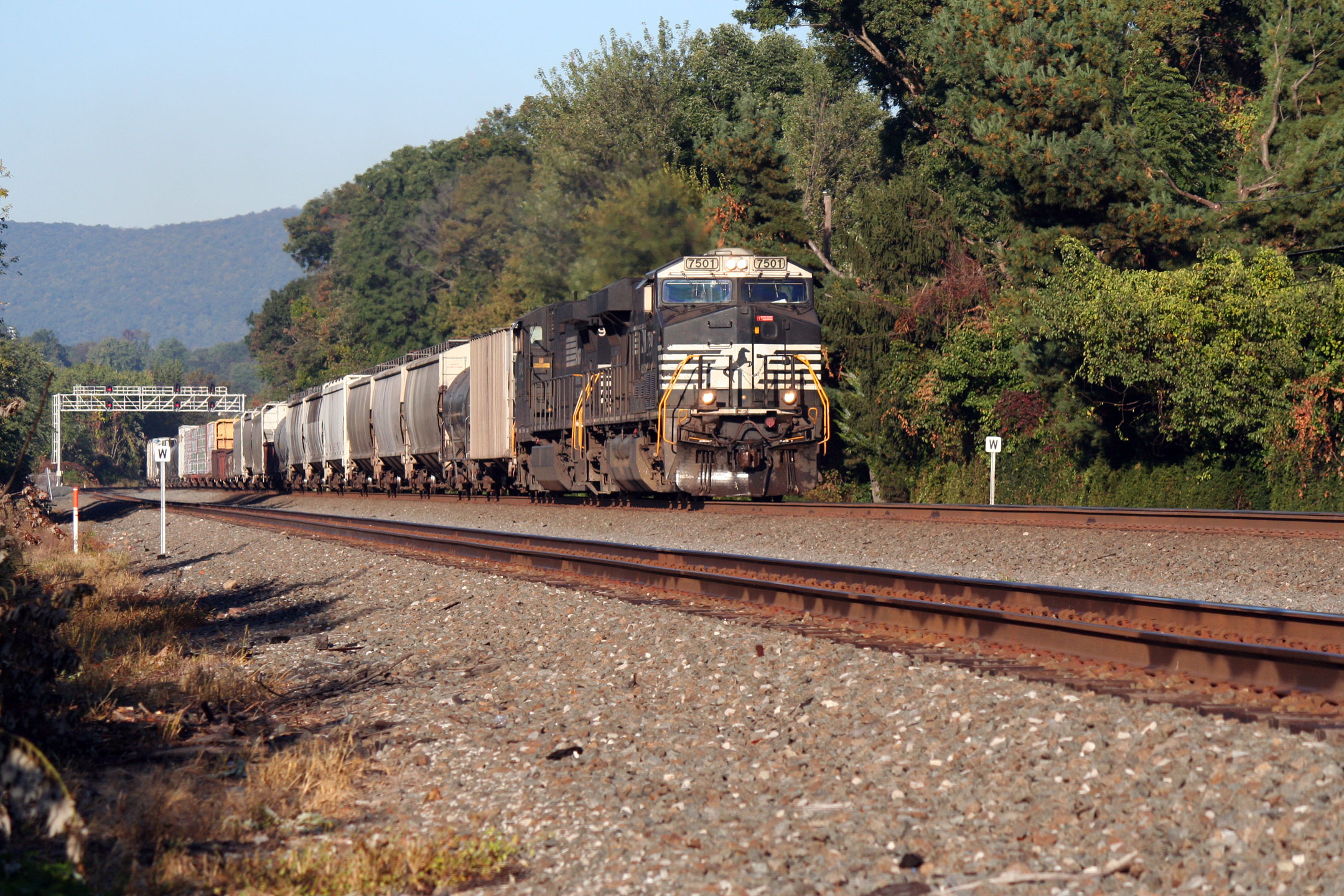 Our first train of the morning, an eastbound manifest blows through Cove PA, headed for Harrisburg.