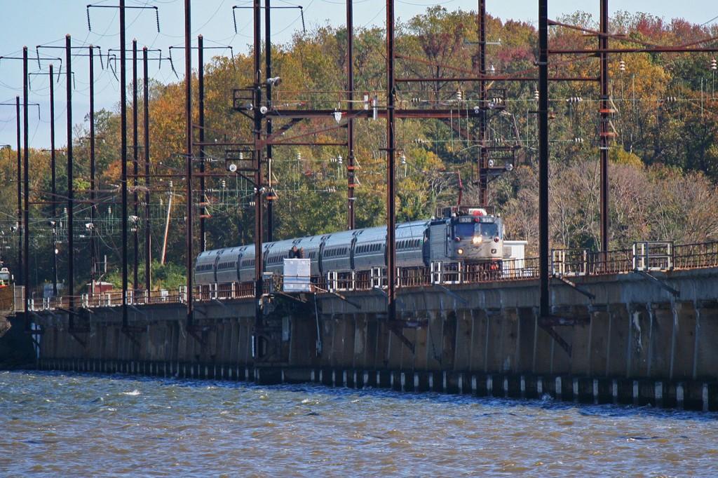 A veteran AEM7 leads this southbound Amtrak regional across the Bush River bridge.