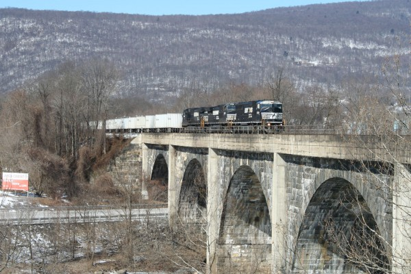 The daily eastbound Roadrailer train heads onto the bridge at Mount Union.