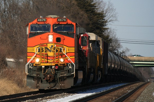 A BNSF Dash 9 leads K043 west.