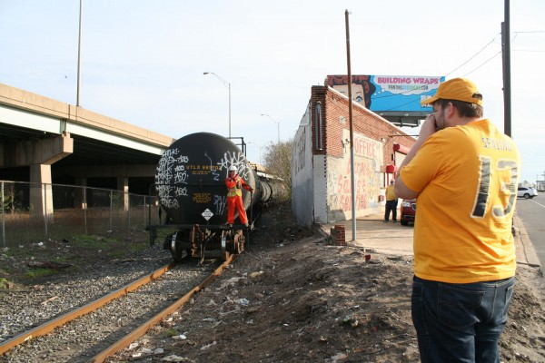 My friend Ben captures the first view of the train, emerging from behind the local businesses.