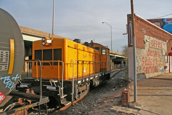 Railserve 1234 comes into view behind the oddly shaped carpet company on Aramingo Avenue.