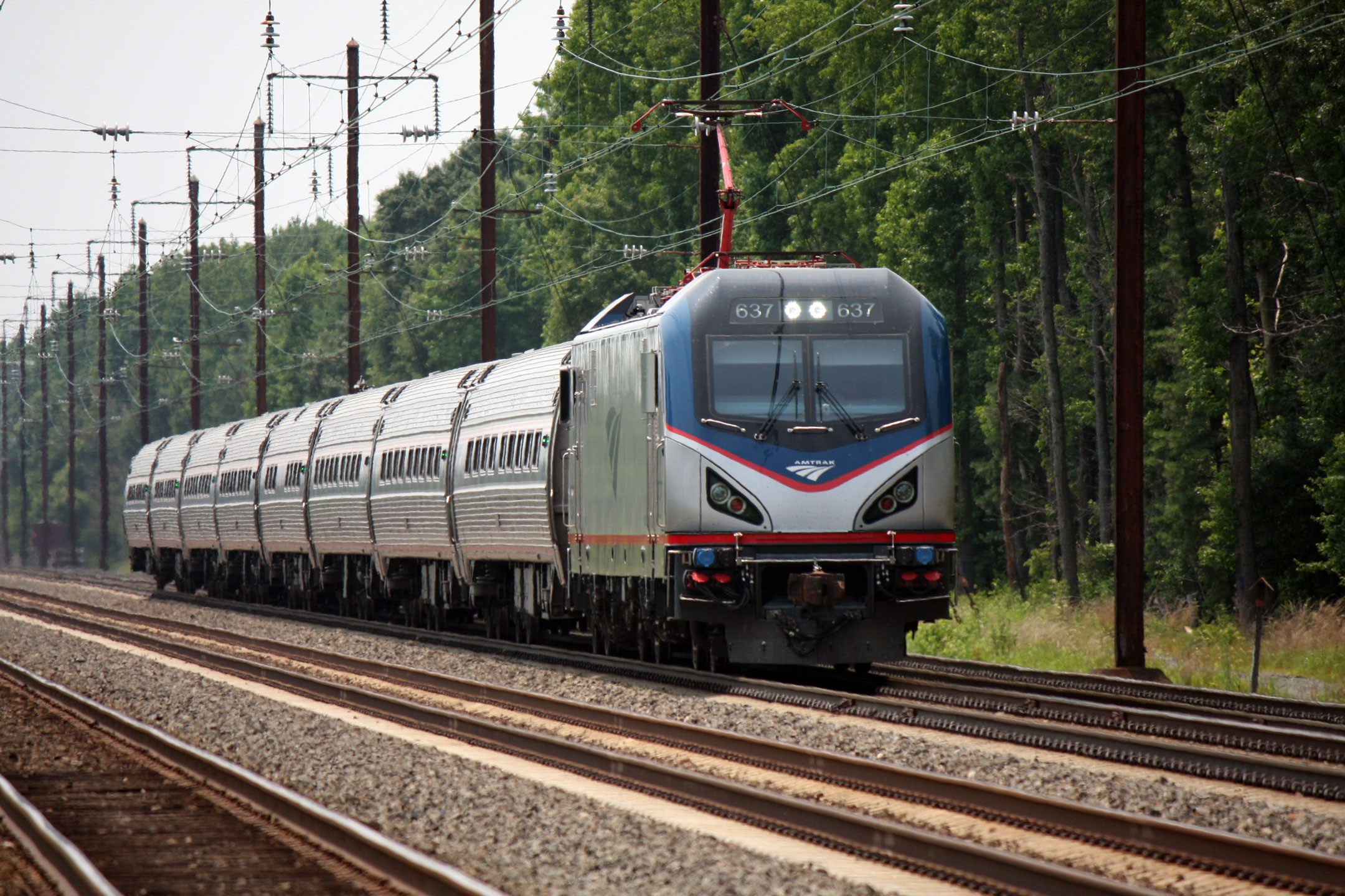 A new ACS-64 heads a north bound Northeast Regional train.